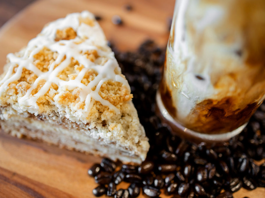 Merit Auto Spa Cafe Coffee Cake with Coffee Beans and Iced Coffee on Walnut Counter Table
